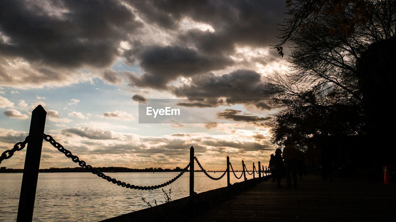 sunset, silhouette, sky, bridge - man made structure, outdoors, cloud - sky, built structure, travel destinations, architecture, beauty in nature, nature, no people, tree, day
