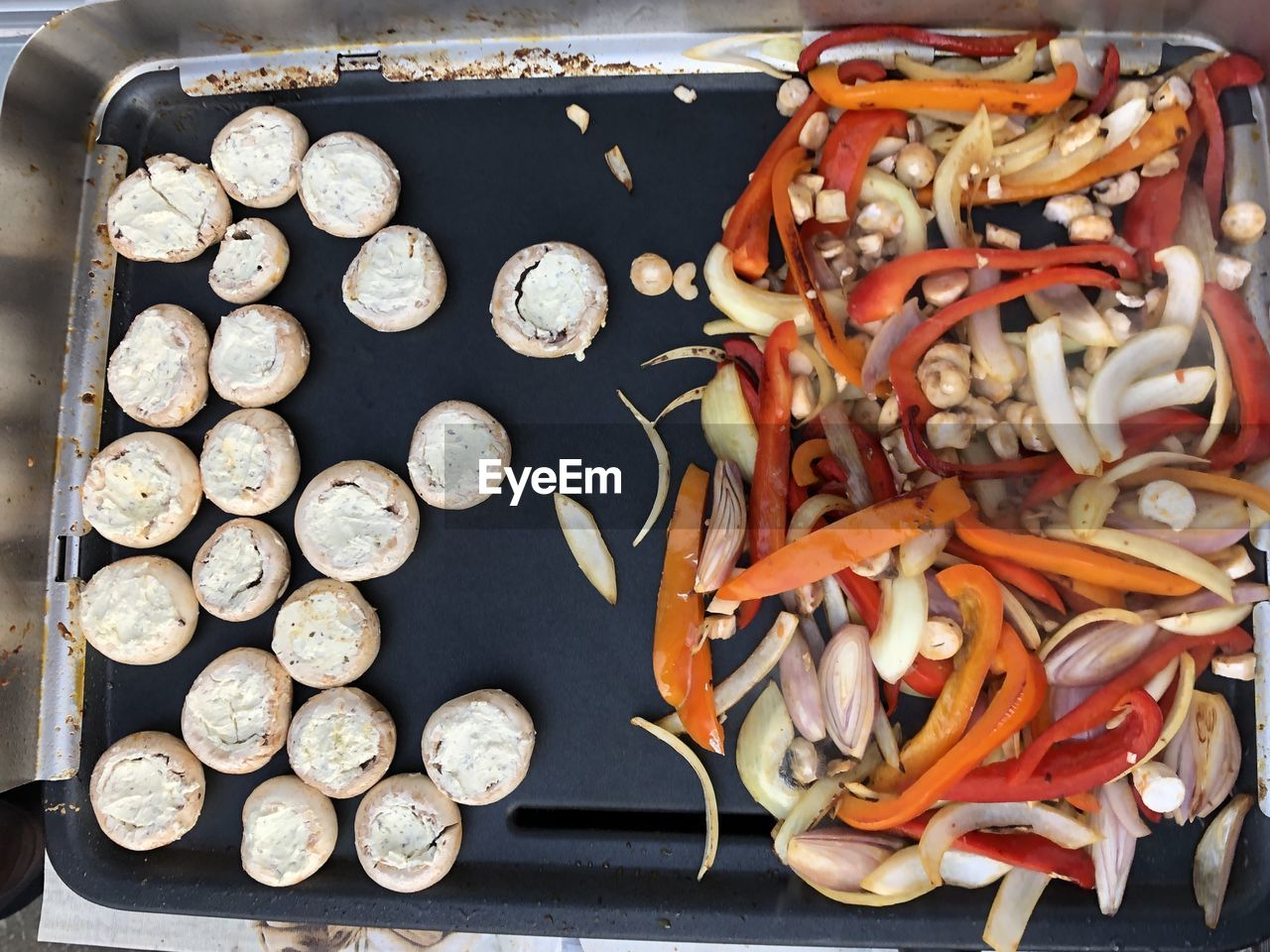 HIGH ANGLE VIEW OF CARROTS ON BARBECUE GRILL