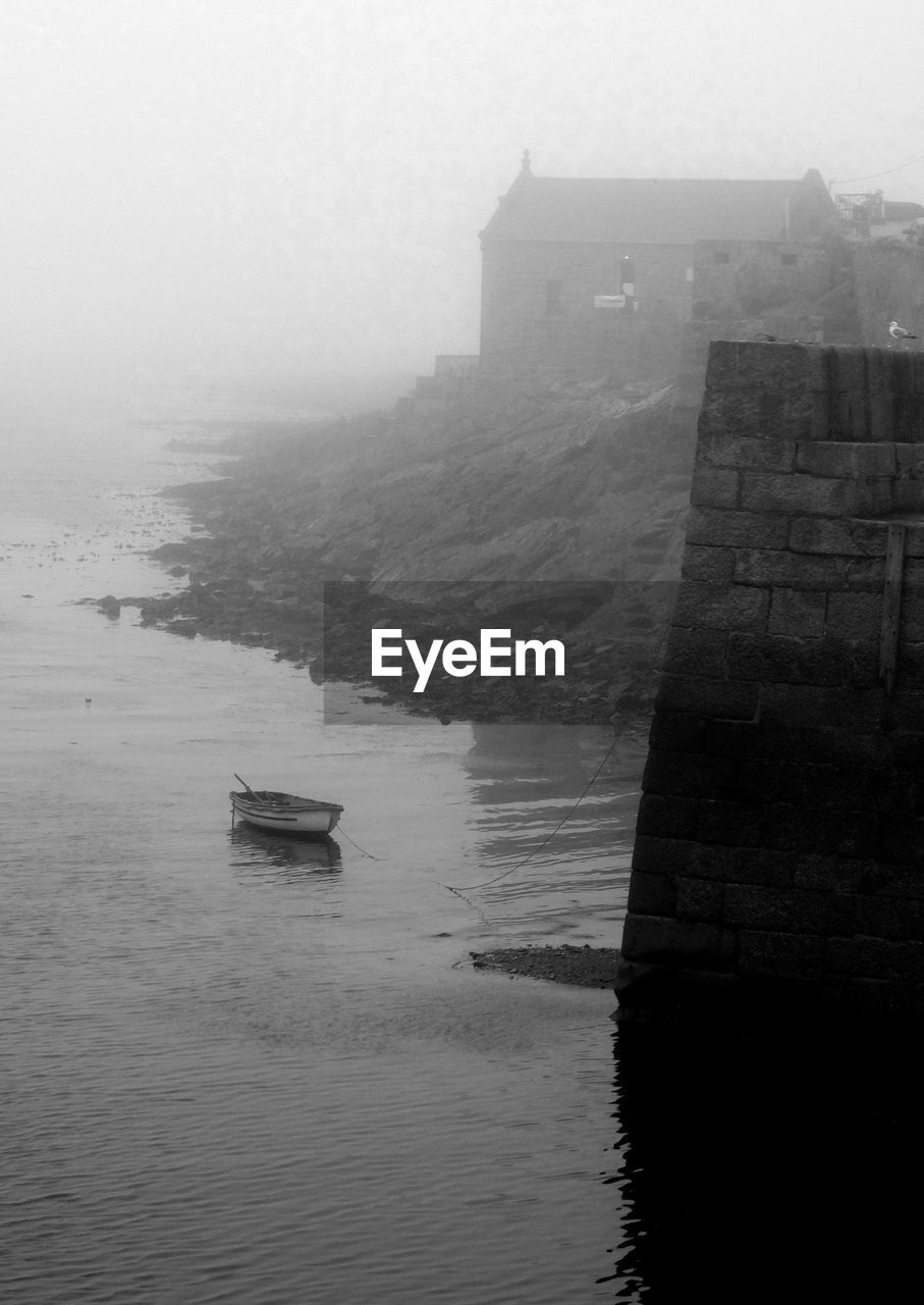 water, architecture, nautical vessel, no people, built structure, outdoors, sea, nature, fog, day, building exterior, sky