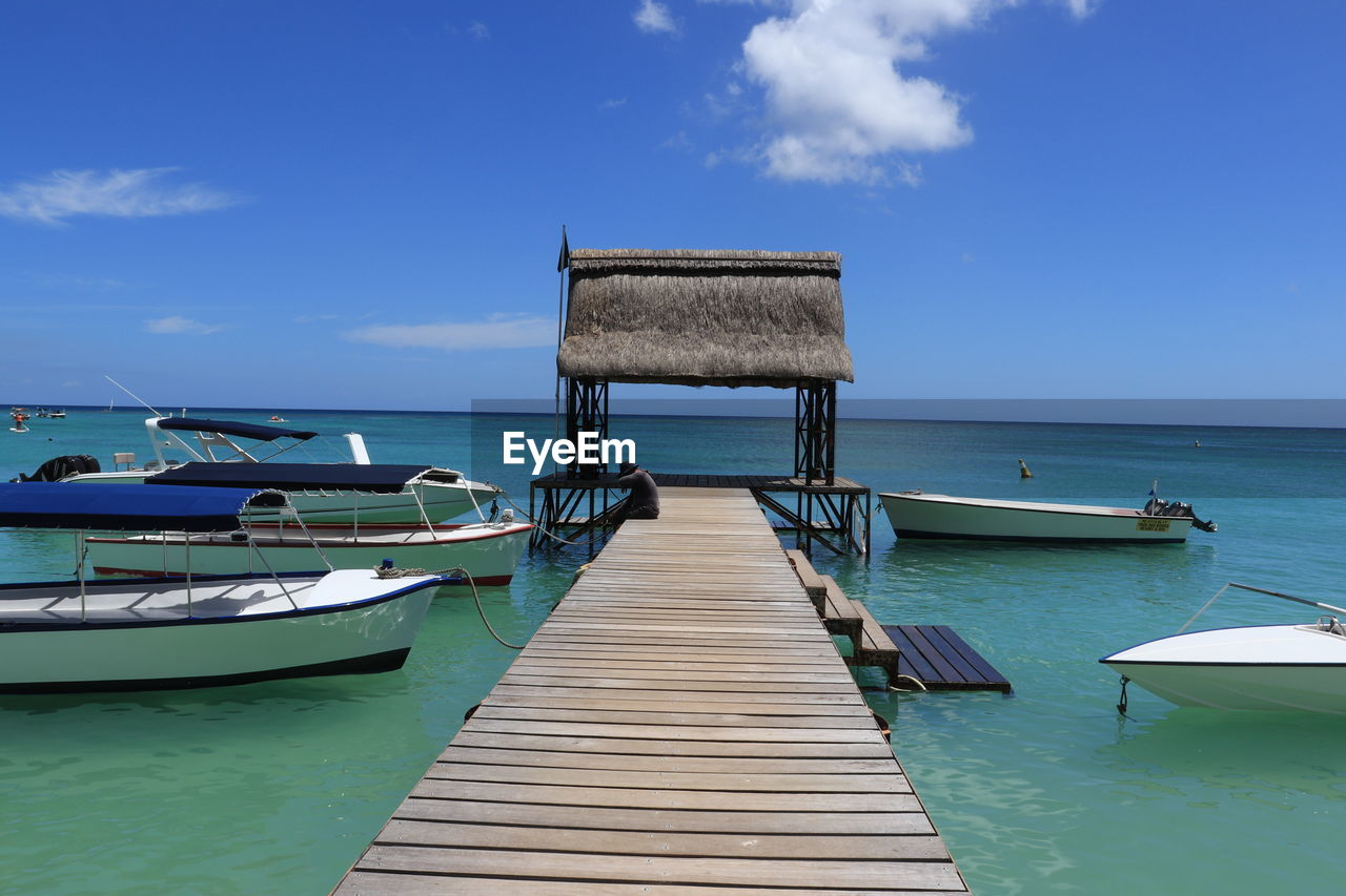 sky, water, cloud - sky, wood - material, pier, sea, beauty in nature, scenics - nature, nature, day, blue, no people, horizon over water, tranquility, architecture, tranquil scene, built structure, jetty, horizon, outdoors, wood paneling, turquoise colored