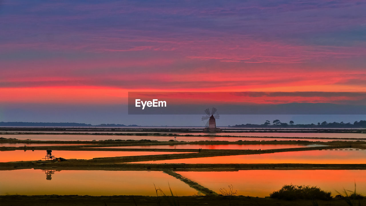 sky, sunset, orange color, beauty in nature, scenics - nature, cloud - sky, tranquil scene, water, nature, tranquility, no people, non-urban scene, idyllic, outdoors, environment, landscape, architecture, agriculture, tower, salt flat