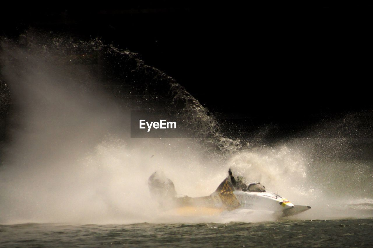 motion, power in nature, water, outdoors, adventure, risk, one person, nature, sea, night, beauty in nature, crash, sky, people