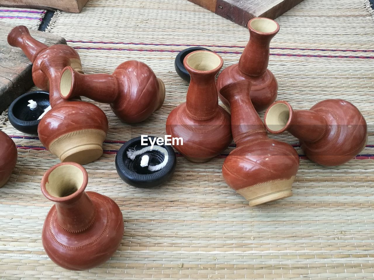High Angle View Of Earthenware On Mat For Sale