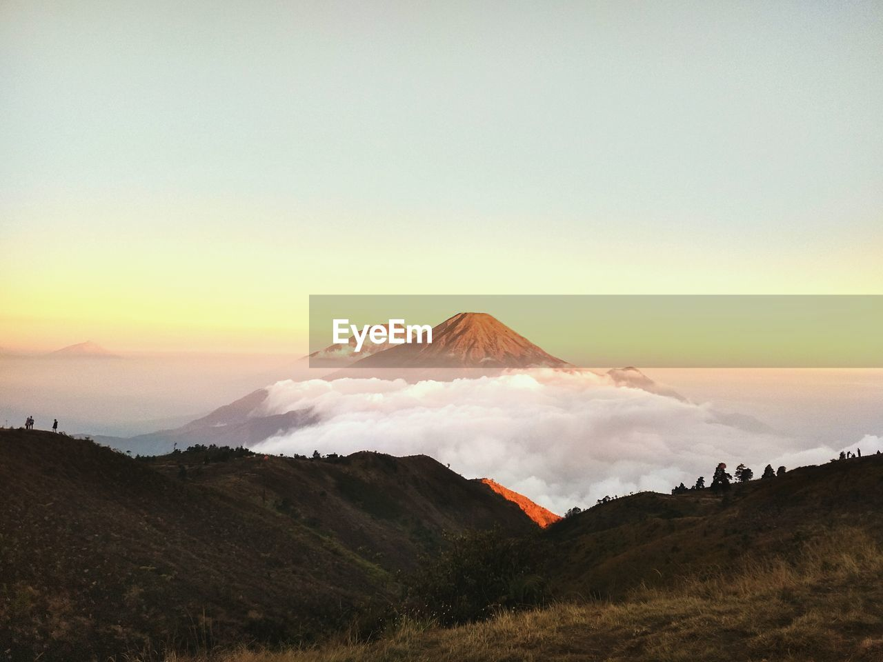 VIEW OF VOLCANIC MOUNTAIN AGAINST SKY DURING SUNSET