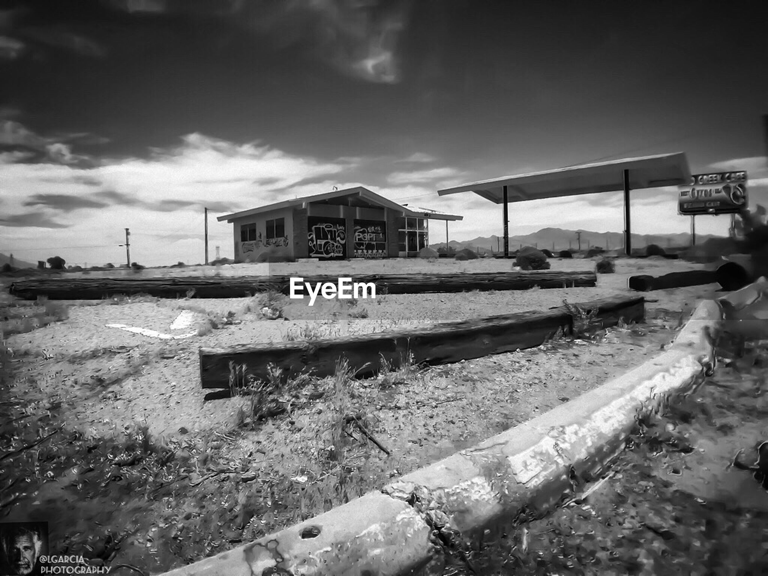 sky, built structure, building exterior, architecture, abandoned, obsolete, cloud - sky, damaged, transportation, day, run-down, house, field, outdoors, deterioration, old, cloud, no people, mode of transport, sunlight