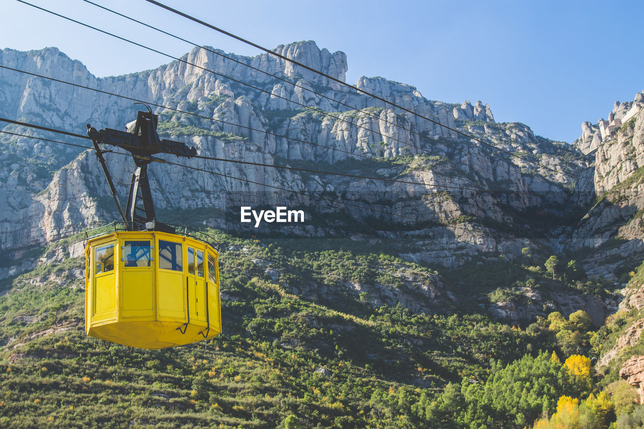Low Angle View Of Overhead Cable Car Against Rocky Mountains At Montserrat