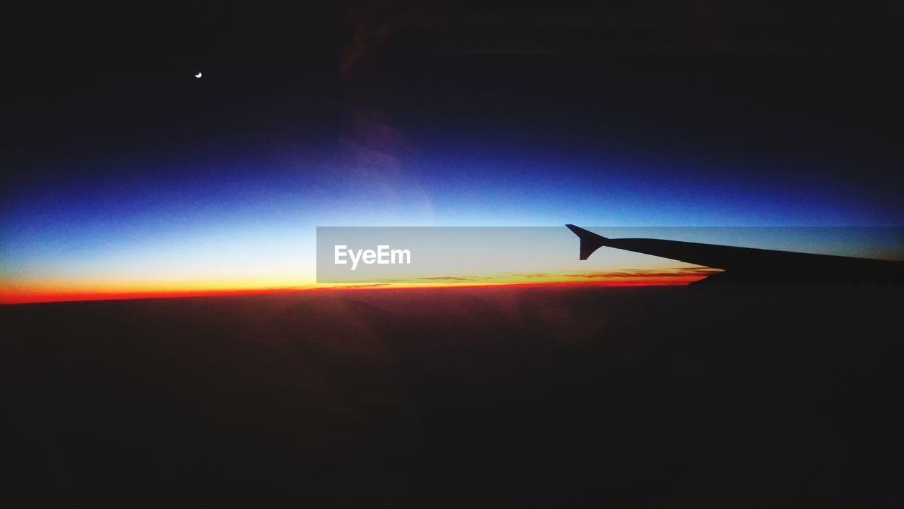 airplane, transportation, airplane wing, flying, air vehicle, silhouette, sunset, nature, journey, sky, mode of transport, travel, beauty in nature, scenics, mid-air, no people, outdoors, aircraft wing, sun, aerial view, day