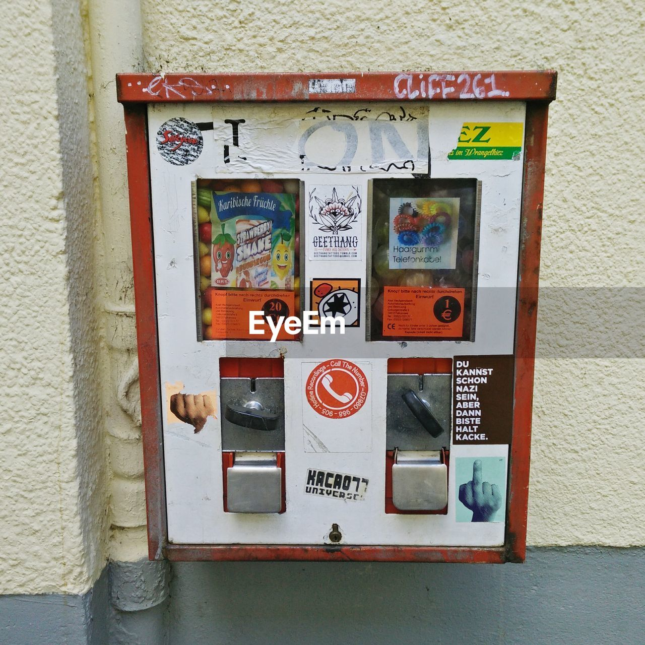 text, machinery, day, bubble gum, no people, vending machine, outdoors, architecture, technology, close-up