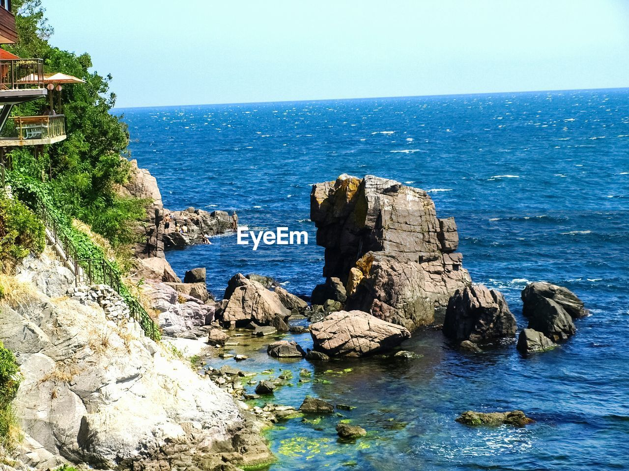 sea, rock - object, water, scenics, rock formation, nature, tranquil scene, horizon over water, beauty in nature, tranquility, no people, clear sky, blue, day, outdoors, sky, cliff