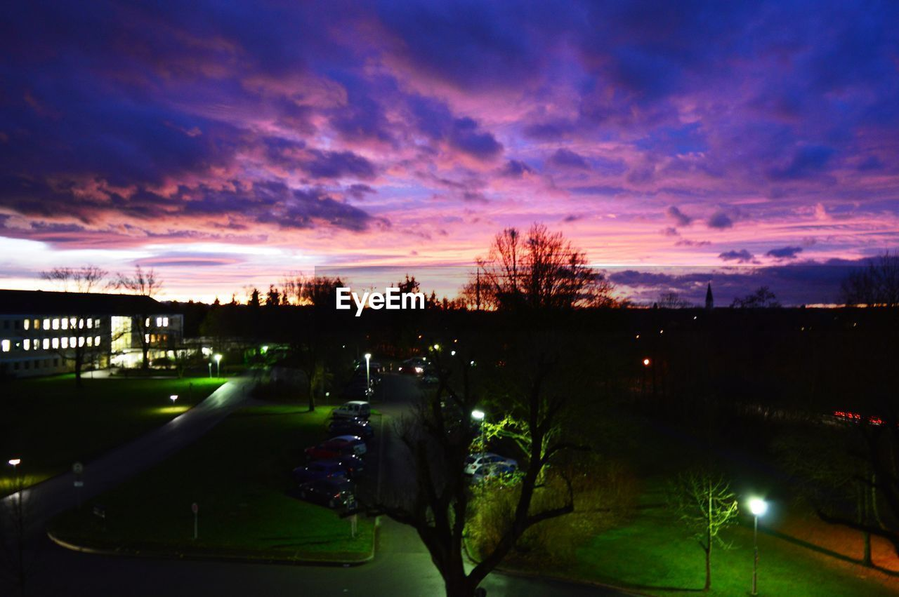sunset, sky, tree, illuminated, dusk, cloud - sky, outdoors, no people, scenics, architecture, night, nature, built structure, beauty in nature, city, building exterior, water