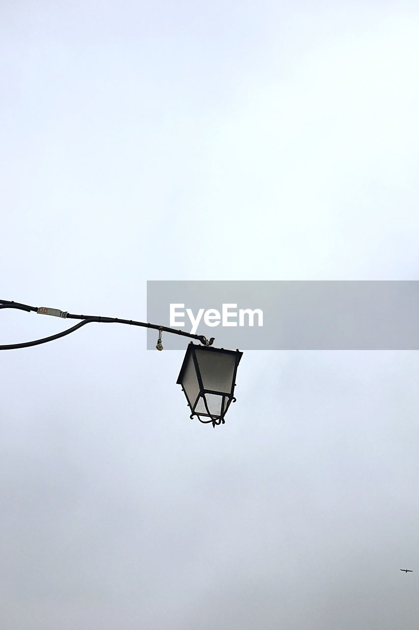 low angle view, outdoors, day, clear sky, electricity, no people, sky, nature