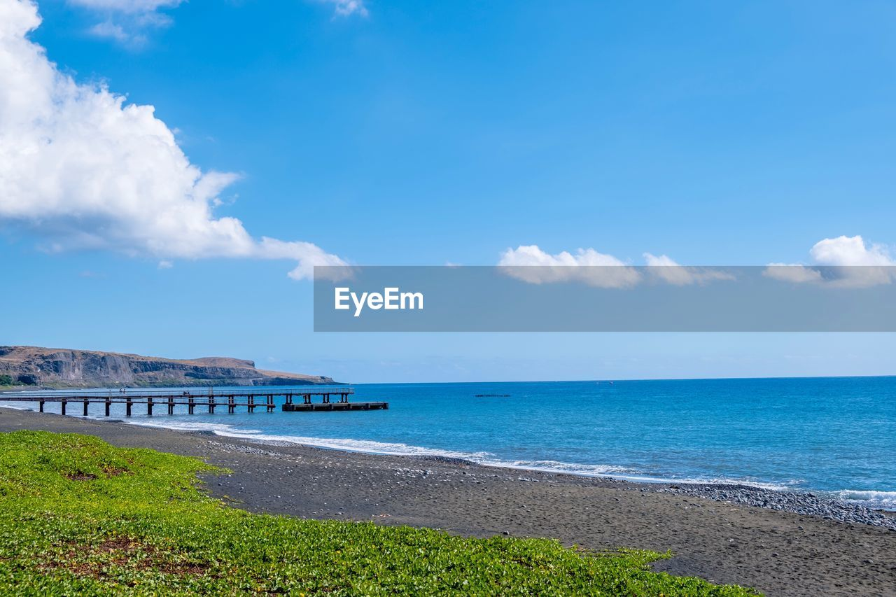 sea, water, sky, scenics - nature, land, beauty in nature, beach, horizon over water, horizon, tranquility, cloud - sky, tranquil scene, blue, day, nature, no people, built structure, idyllic, architecture