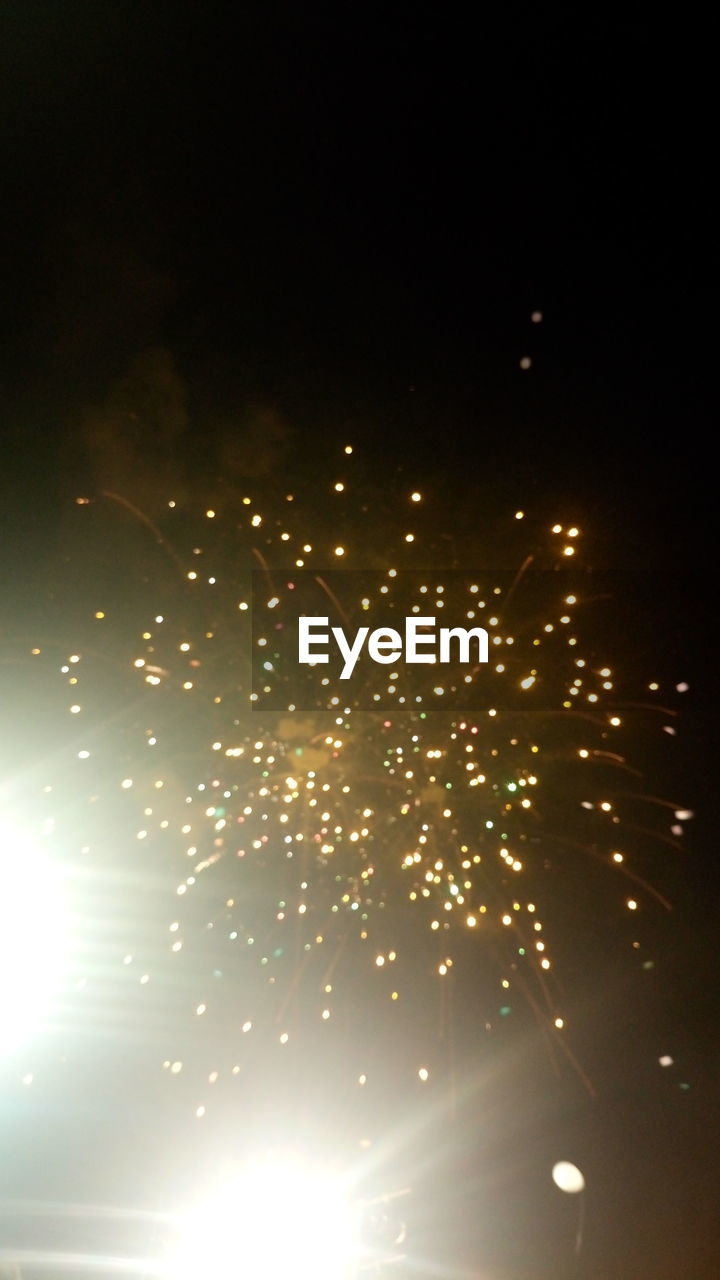 celebration, firework display, night, firework - man made object, arts culture and entertainment, event, exploding, glowing, long exposure, sparks, illuminated, blurred motion, low angle view, motion, outdoors, no people, multi colored, clear sky, sky, firework, flying