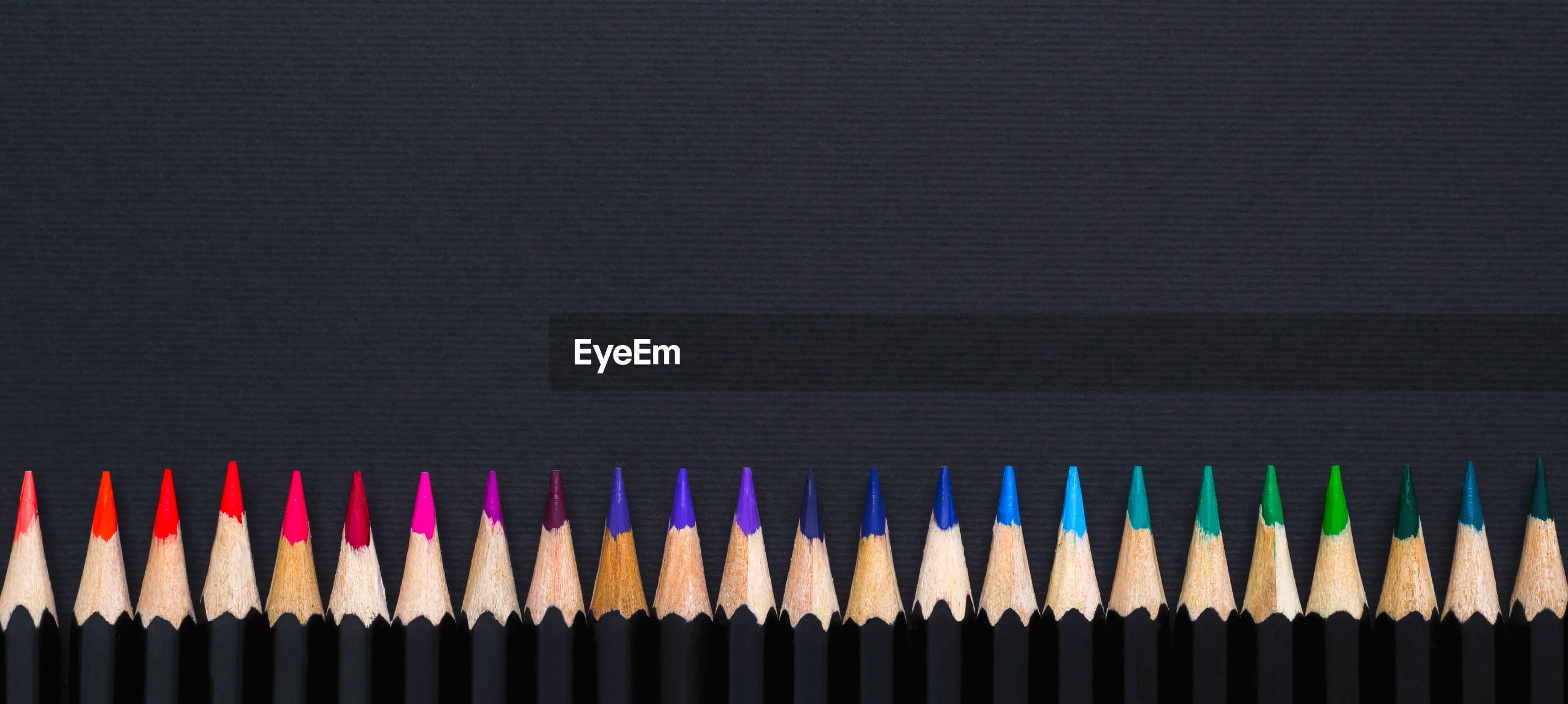 CLOSE-UP OF MULTI COLORED PENCILS IN BACKGROUND