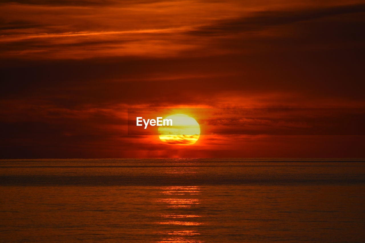 sky, sunset, orange color, scenics - nature, cloud - sky, beauty in nature, sea, horizon over water, sun, water, idyllic, tranquil scene, horizon, tranquility, nature, waterfront, no people, sunlight, reflection, outdoors, astronomy, romantic sky, eclipse