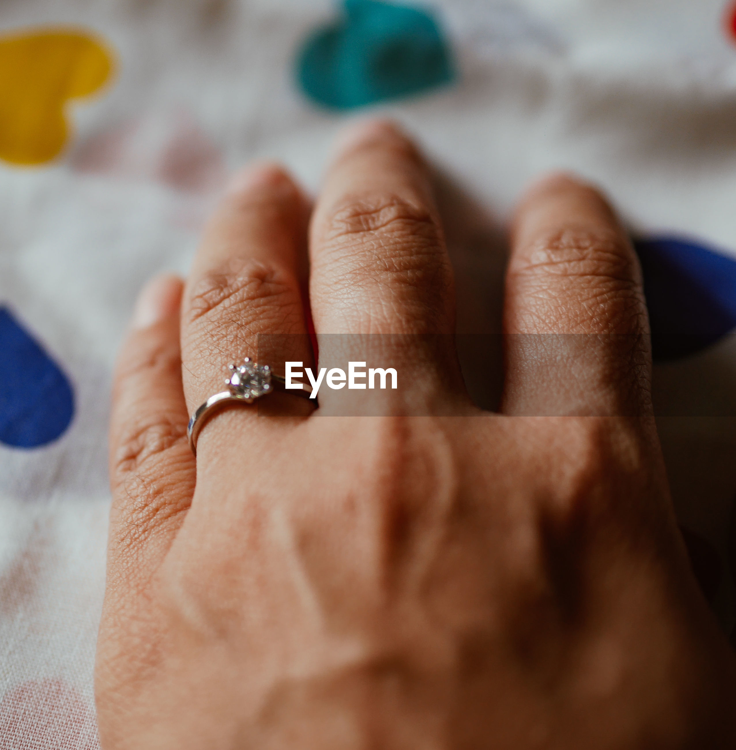 Close-up of hand wearing ring