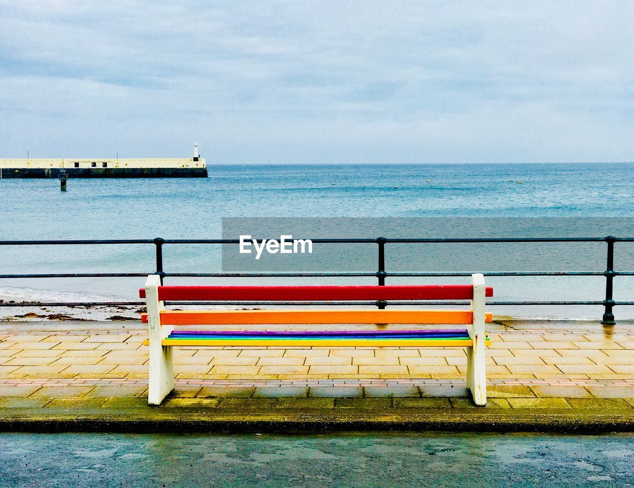 water, sea, sky, horizon over water, horizon, scenics - nature, nautical vessel, beauty in nature, cloud - sky, nature, transportation, tranquility, no people, tranquil scene, day, land, mode of transportation, beach, railing, outdoors