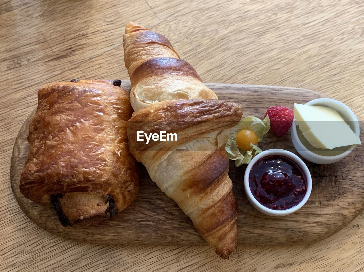 food and drink, food, freshness, ready-to-eat, bread, table, still life, meal, meat, wood - material, close-up, indoors, no people, high angle view, healthy eating, serving size, breakfast, wellbeing, condiment, fruit, snack, temptation, french food, serving dish