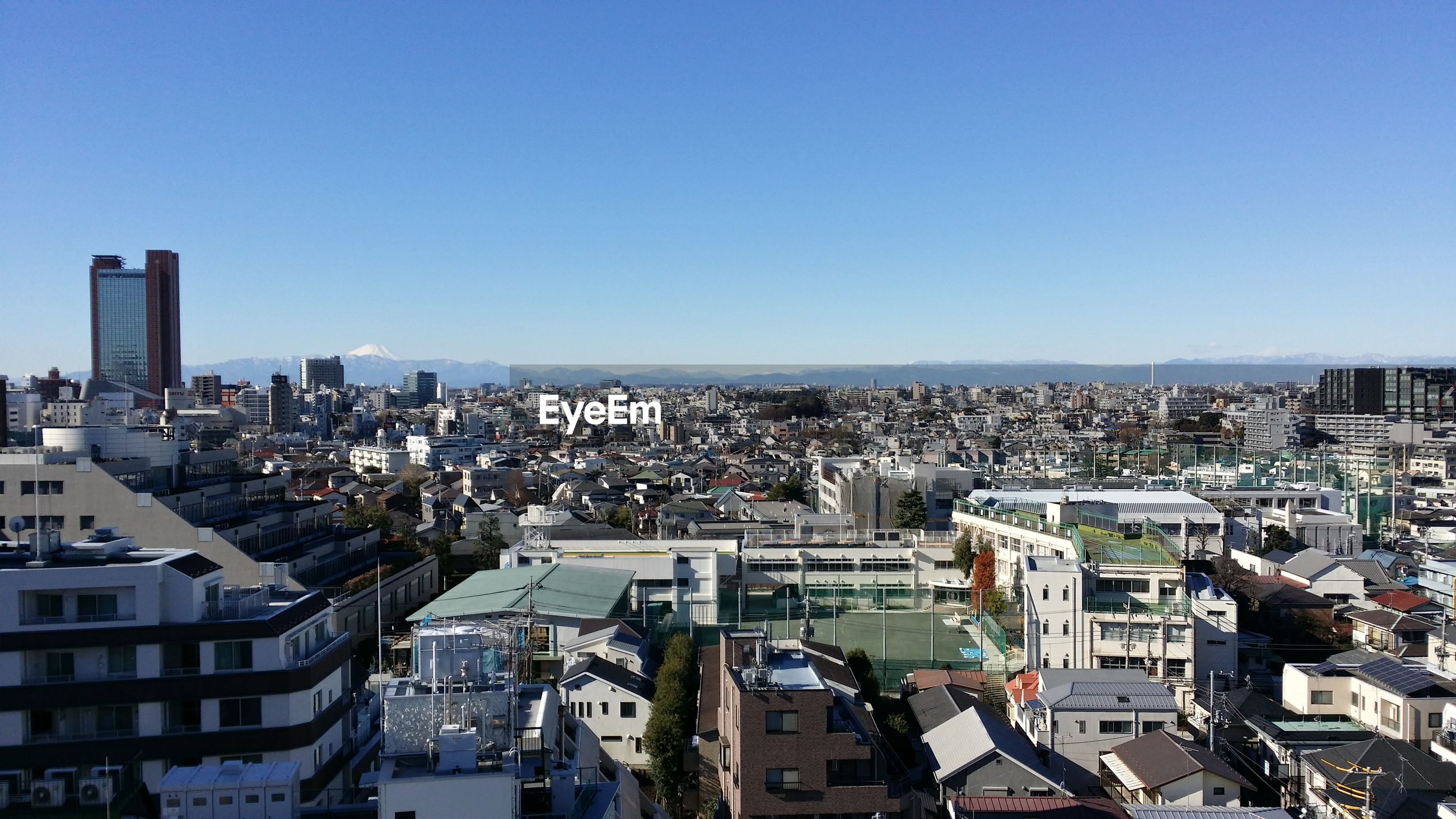 Aerial view of buildings against clear sky in city