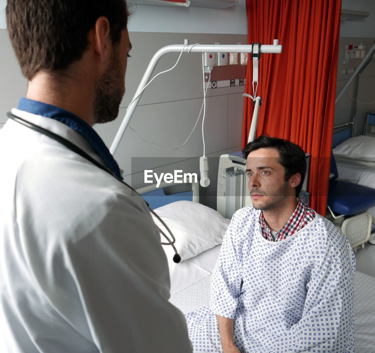 High Angle View Of Doctor With Patient In Examination Room