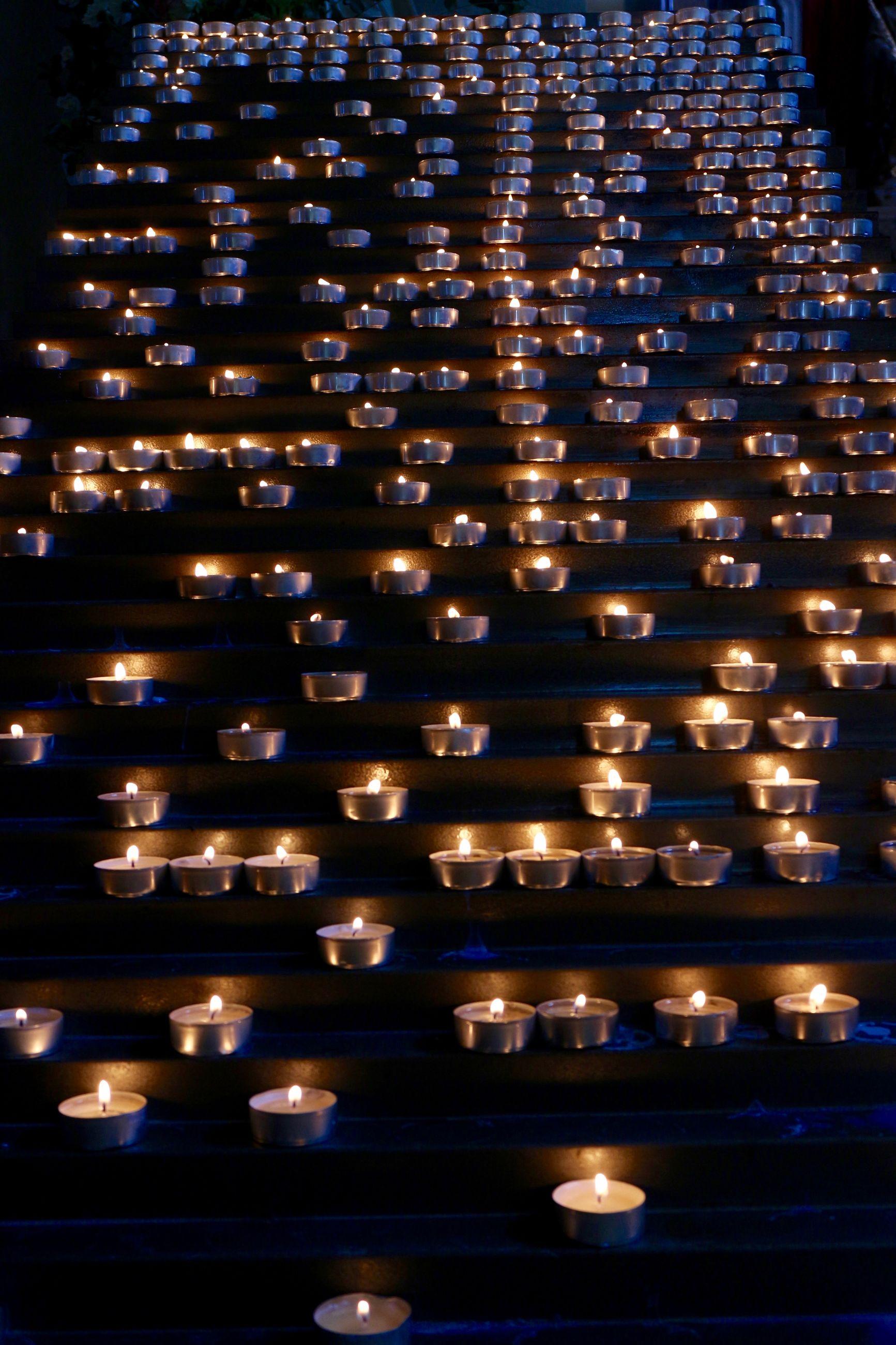 Close-up of lit tea light candles