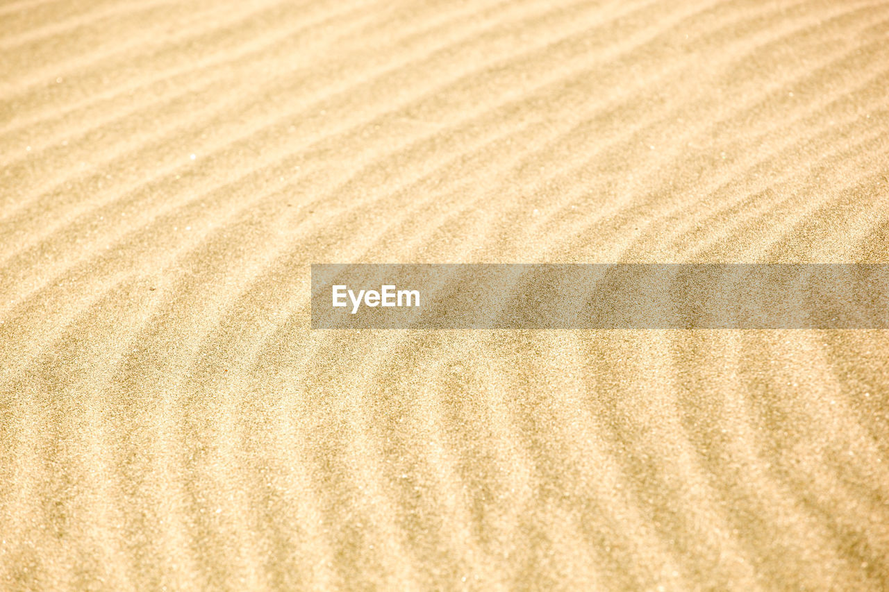 pattern, backgrounds, sand, full frame, land, textured, wave pattern, no people, close-up, nature, natural pattern, beige, tranquility, brown, landscape, beach, wood - material, high angle view, surface level, textured effect, clean, wood grain, arid climate, climate
