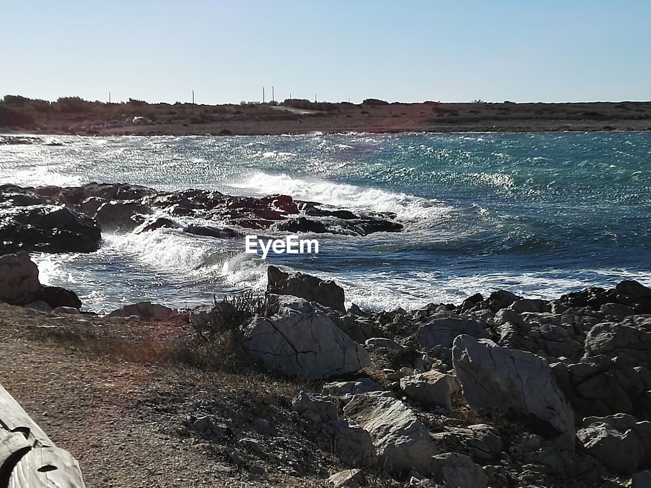 sea, water, wave, nature, beach, rock - object, beauty in nature, sunlight, outdoors, day, no people, clear sky, horizon over water, scenics, tranquility, sky