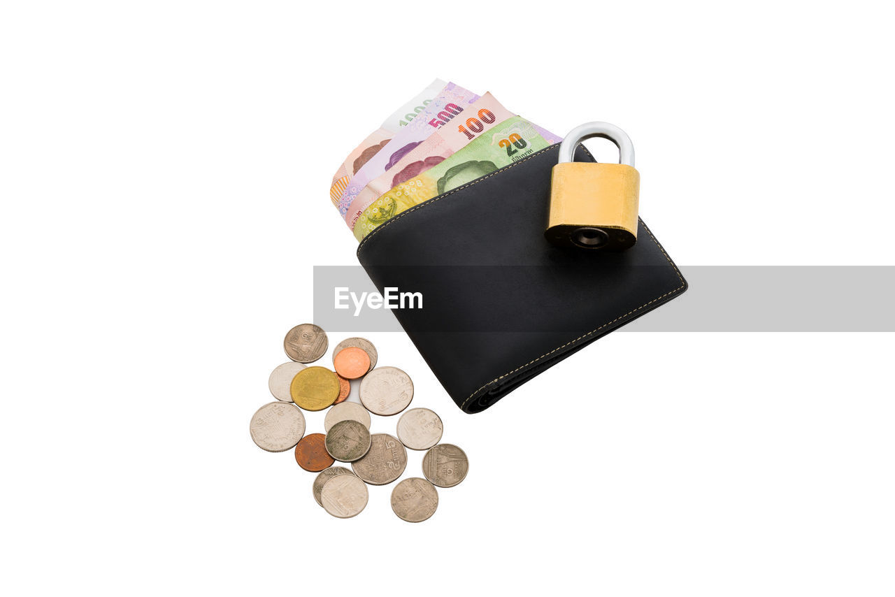 finance, studio shot, white background, currency, still life, wealth, business, copy space, cut out, paper currency, indoors, savings, close-up, coin, metal, investment, no people, large group of objects, high angle view, economy