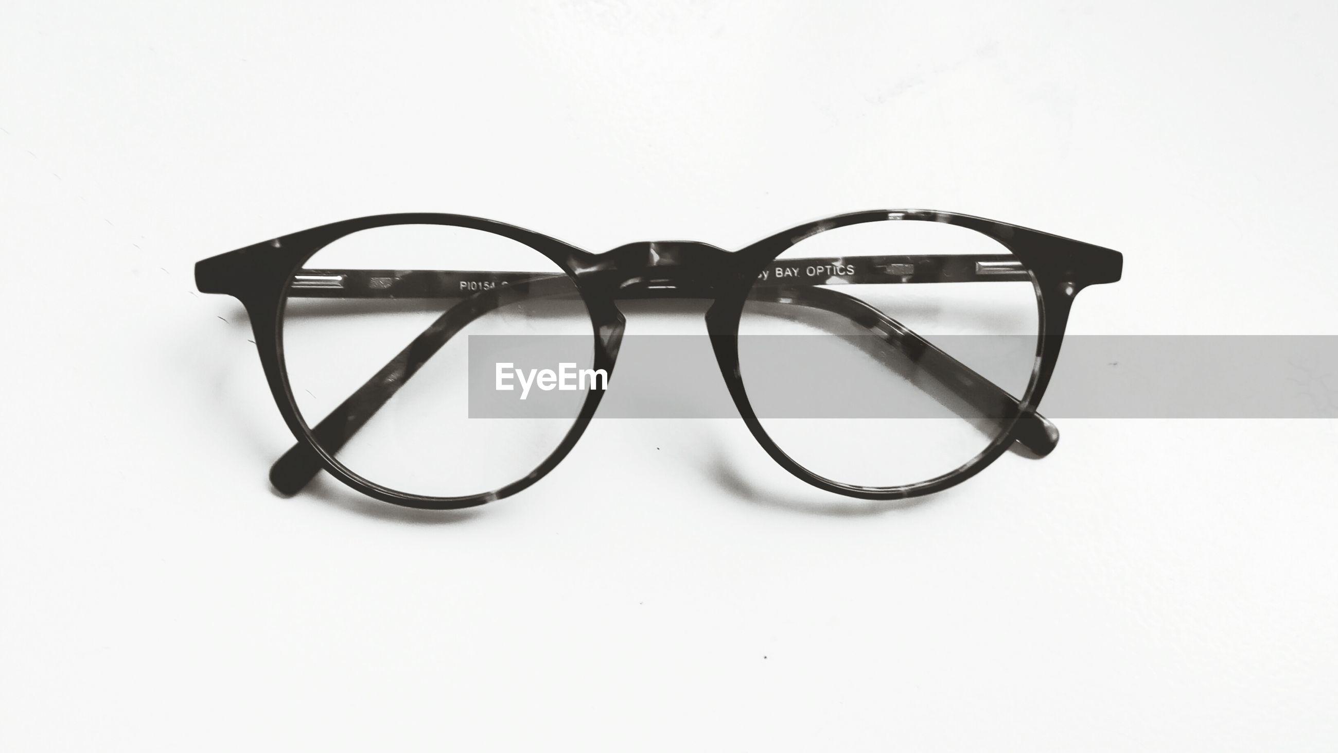 sunglasses, white background, eyewear, eyesight, studio shot, single object, eyeglasses, no people, vision, close-up, day