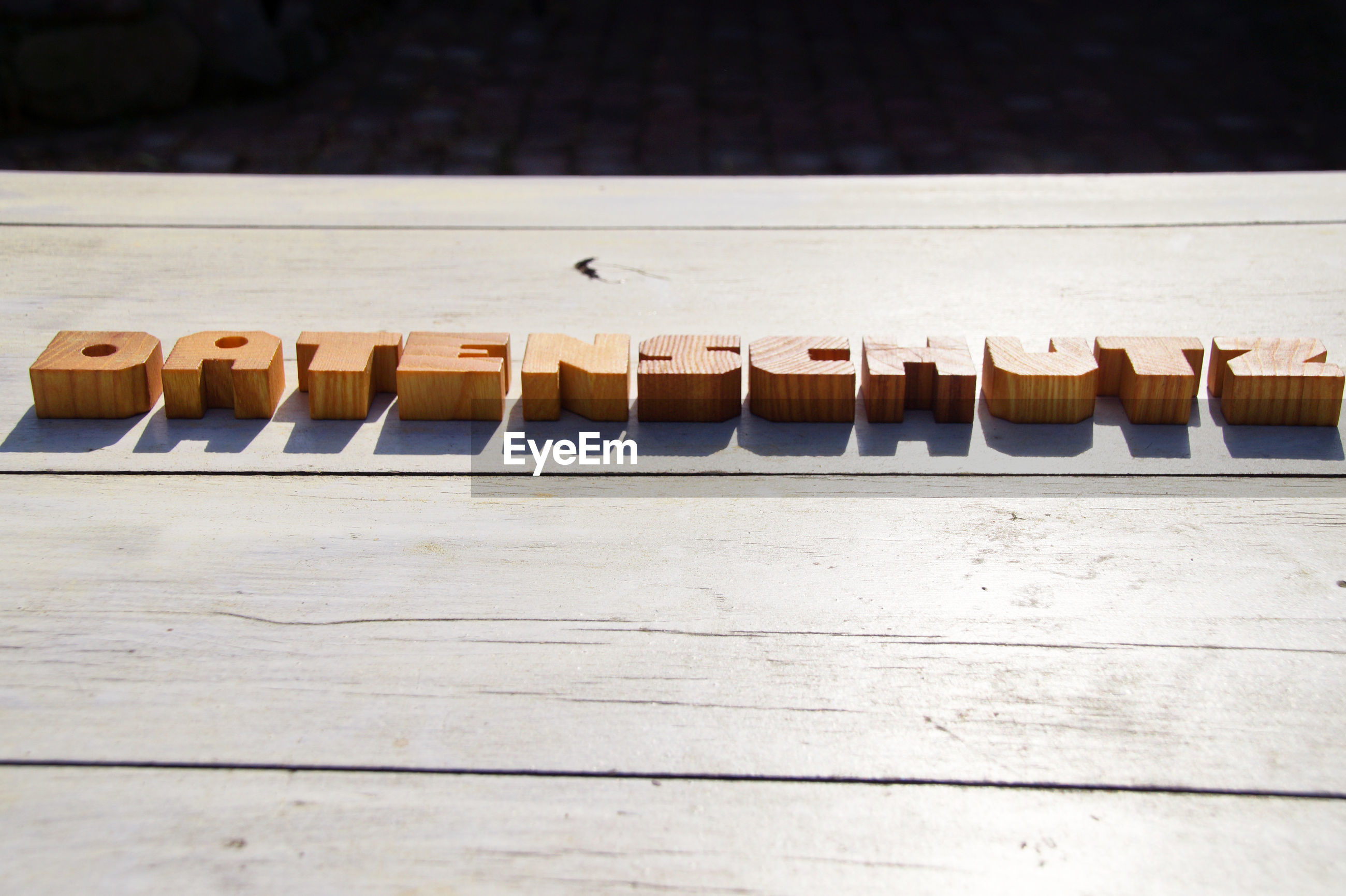 High angle view of wooden alphabets on table