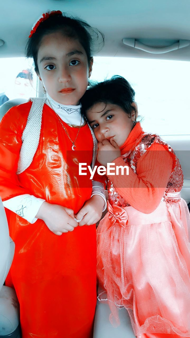 Portrait Of Sisters In Car