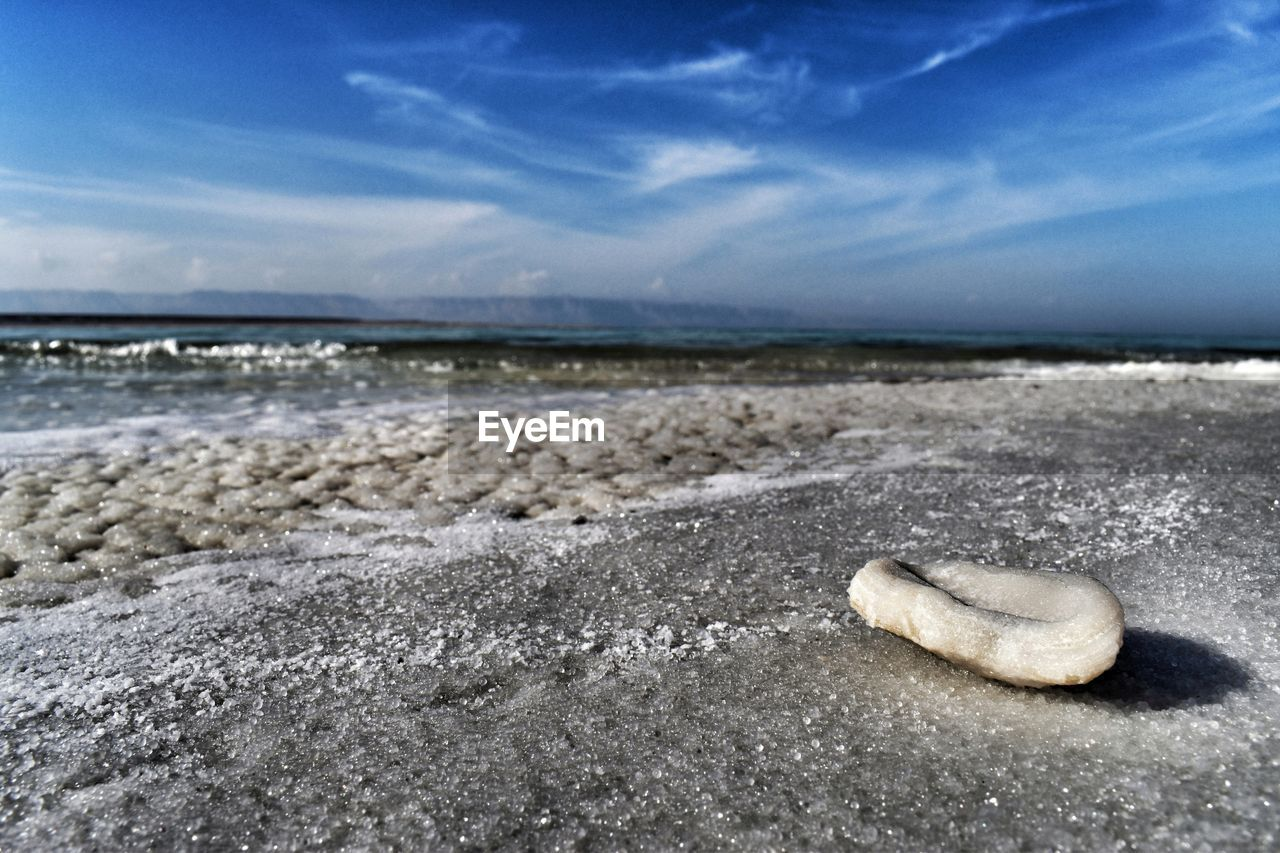 beach, sea, land, sky, water, sand, beauty in nature, nature, horizon over water, scenics - nature, horizon, cloud - sky, rock, no people, tranquility, day, solid, tranquil scene, wave, outdoors, surface level, pebble