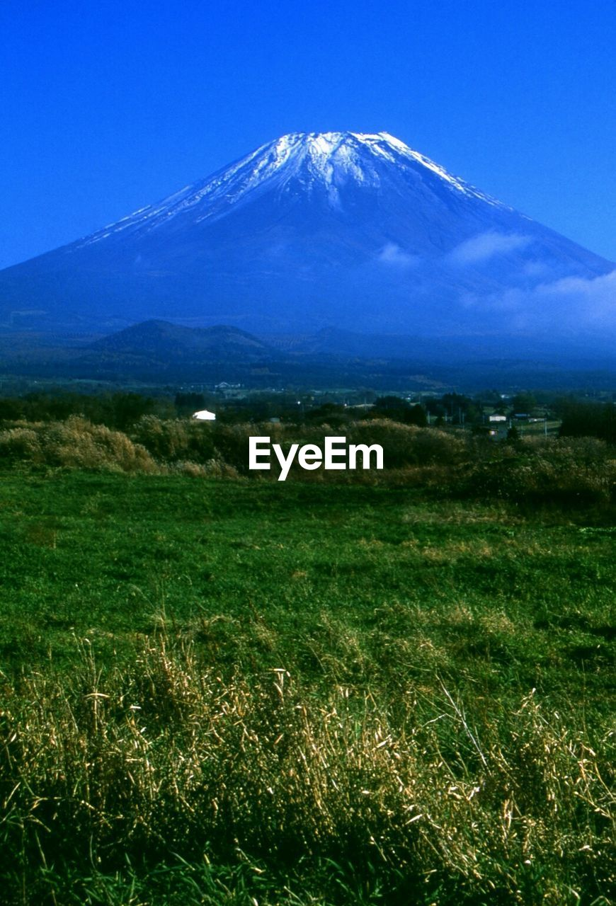 Scenic view of mount fuji against blue sky