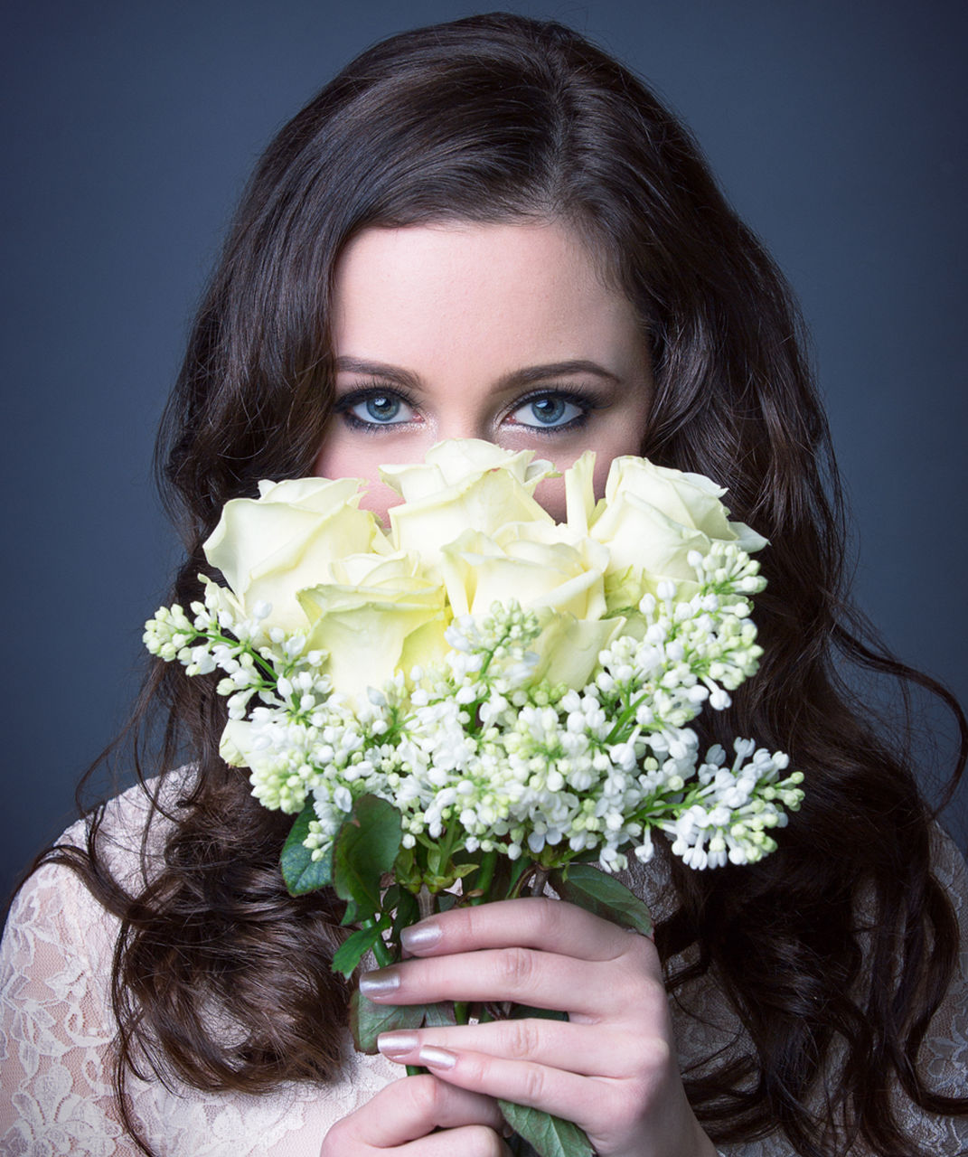 flower, young adult, beautiful woman, young women, looking at camera, one person, bouquet, portrait, one young woman only, beauty, studio shot, freshness, women, front view, close-up, one woman only, headshot, only women, holding, fragility, beautiful people, real people, happiness, adult, adults only, cheerful, smiling, indoors, warm clothing, day, people