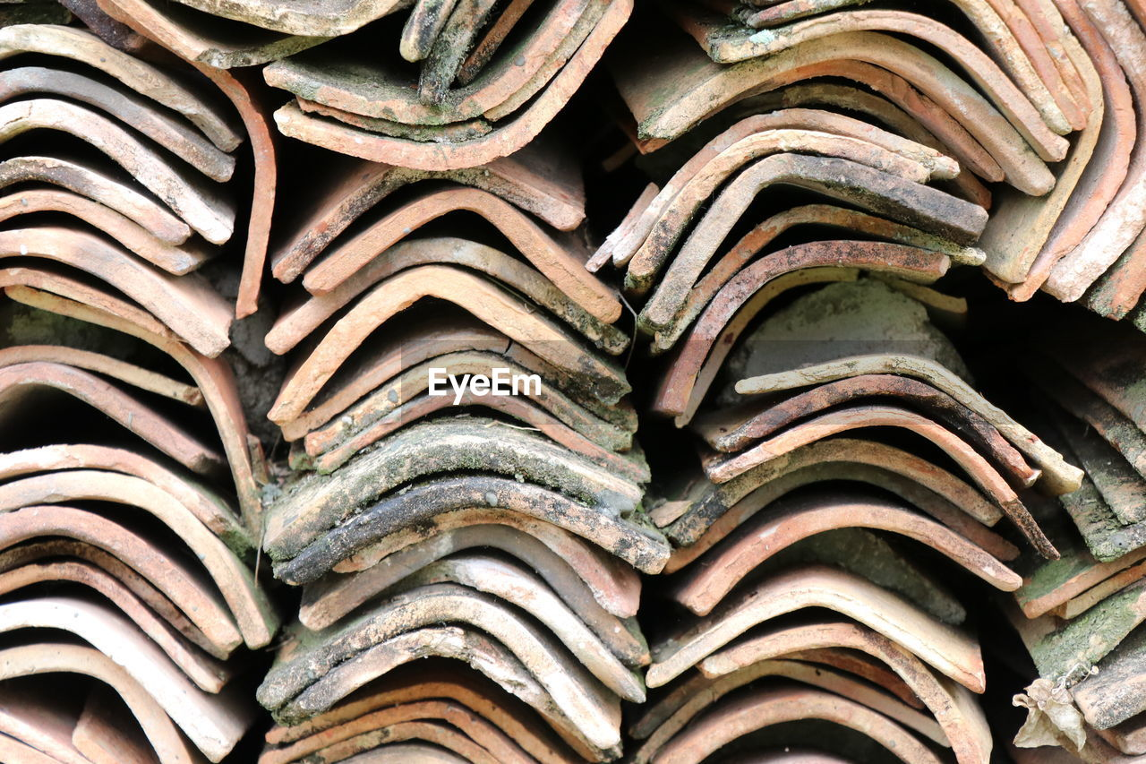 LOW ANGLE VIEW OF ROOF TILES