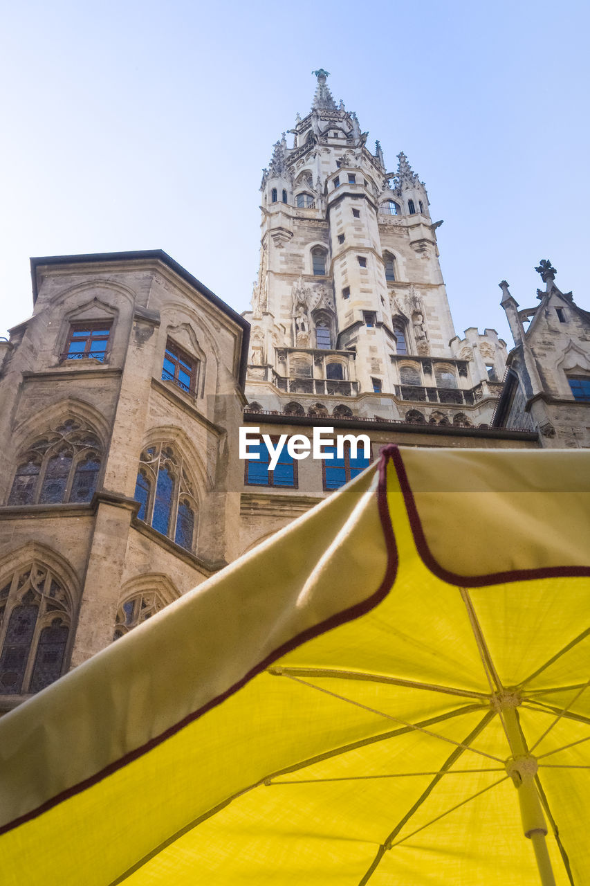 architecture, built structure, building exterior, low angle view, sky, building, spirituality, religion, place of worship, history, travel destinations, the past, belief, nature, no people, clear sky, day, tower, yellow, travel, outdoors, ornate, spire