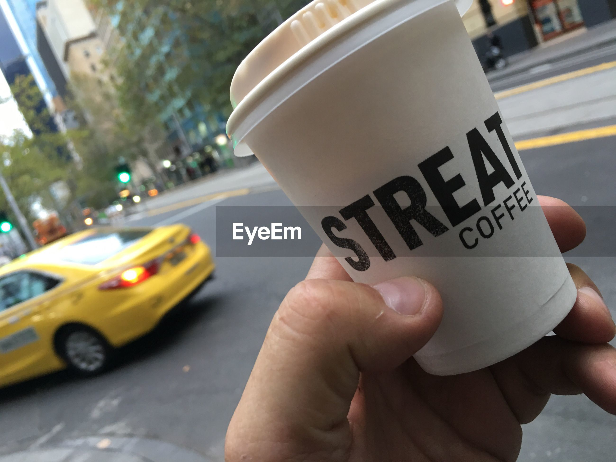 Close-up of hand holding coffee