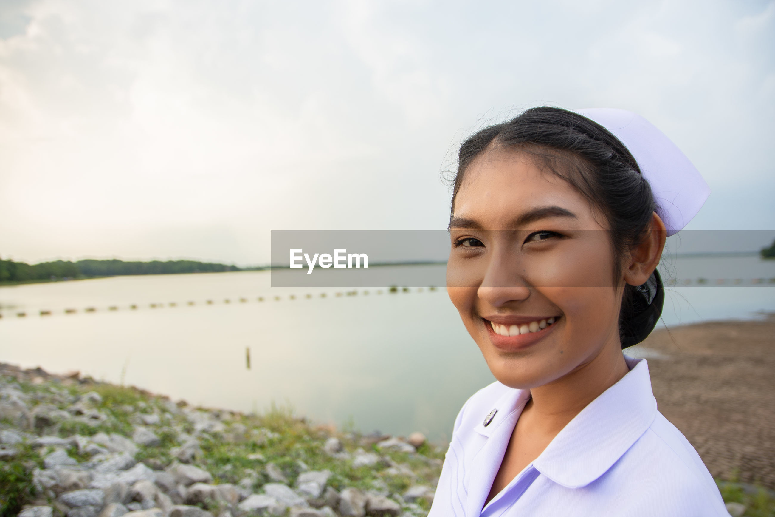 Smiling young nurse on field