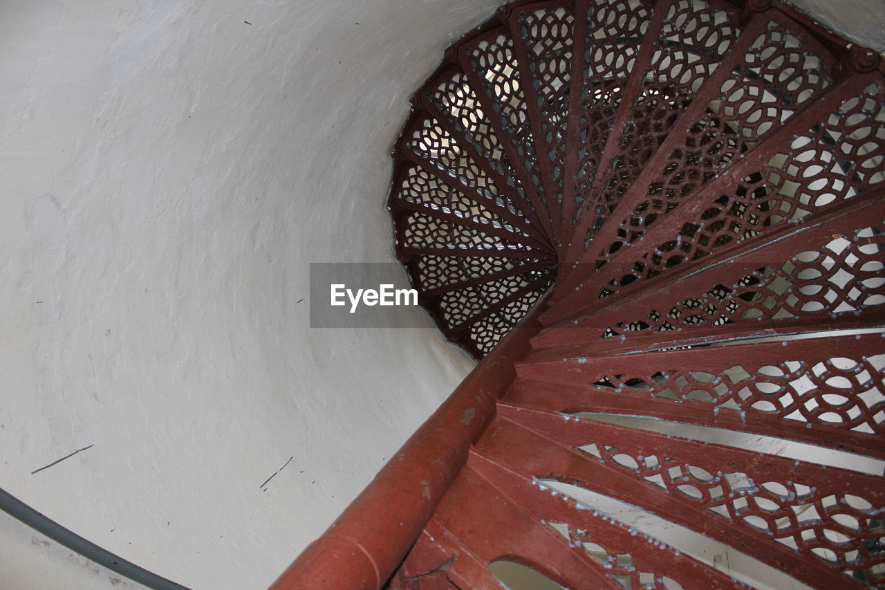 staircase, architecture, steps and staircases, built structure, steps, high angle view, indoors, pattern, no people, day, spiral staircase