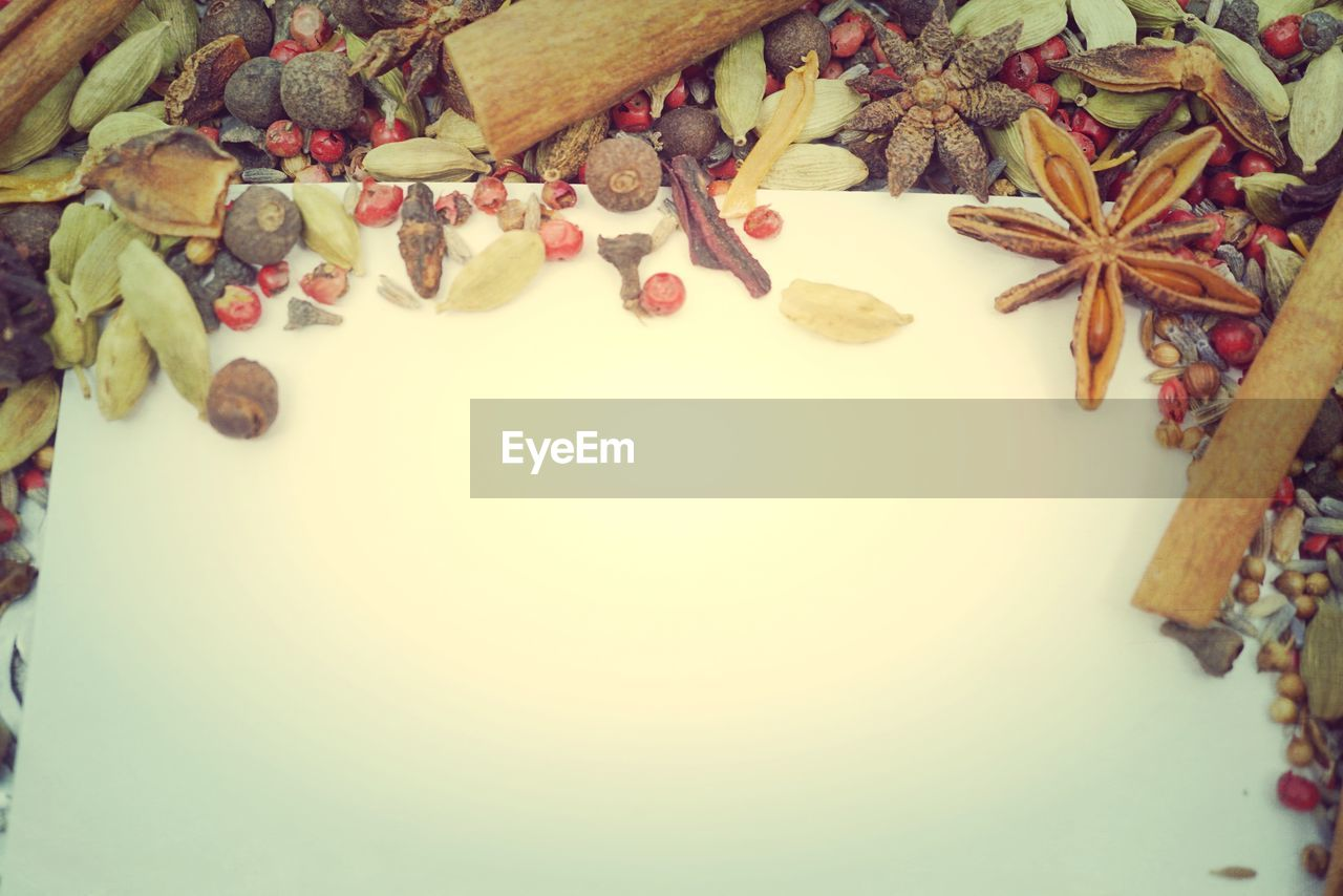 indoors, food and drink, still life, food, no people, high angle view, freshness, spice, star shape, choice, cinnamon, star anise, christmas, table, close-up, variation, large group of objects, decoration, healthy eating, shape