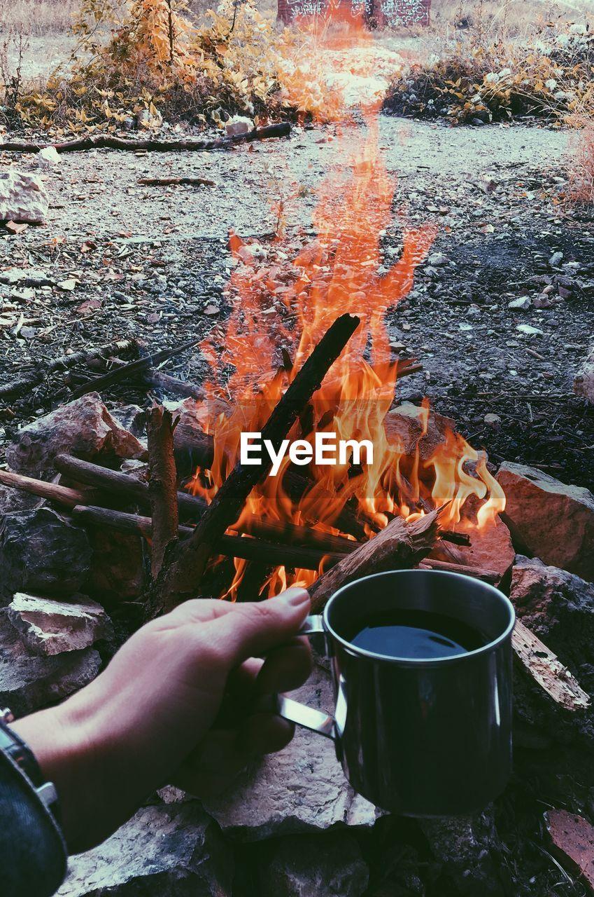 Camp fire and warm coffee