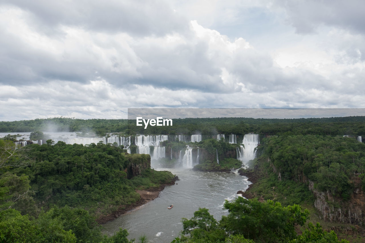 SCENIC VIEW OF WATER FLOWING THROUGH LAND