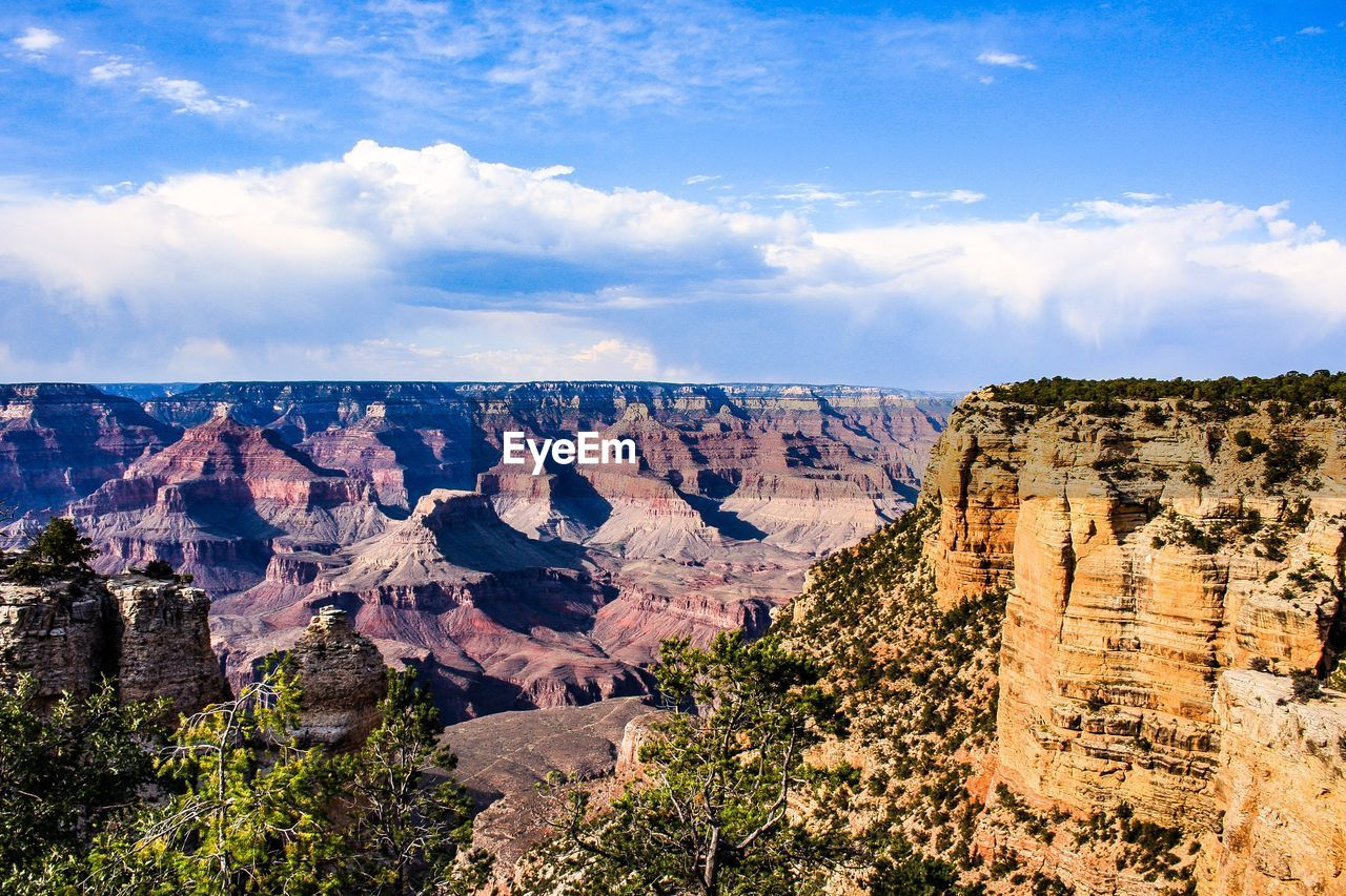 rock formation, geology, rock - object, beauty in nature, tranquil scene, nature, sky, physical geography, cloud - sky, tranquility, scenics, travel destinations, landscape, outdoors, day, no people, mountain, cliff, rock hoodoo, tree