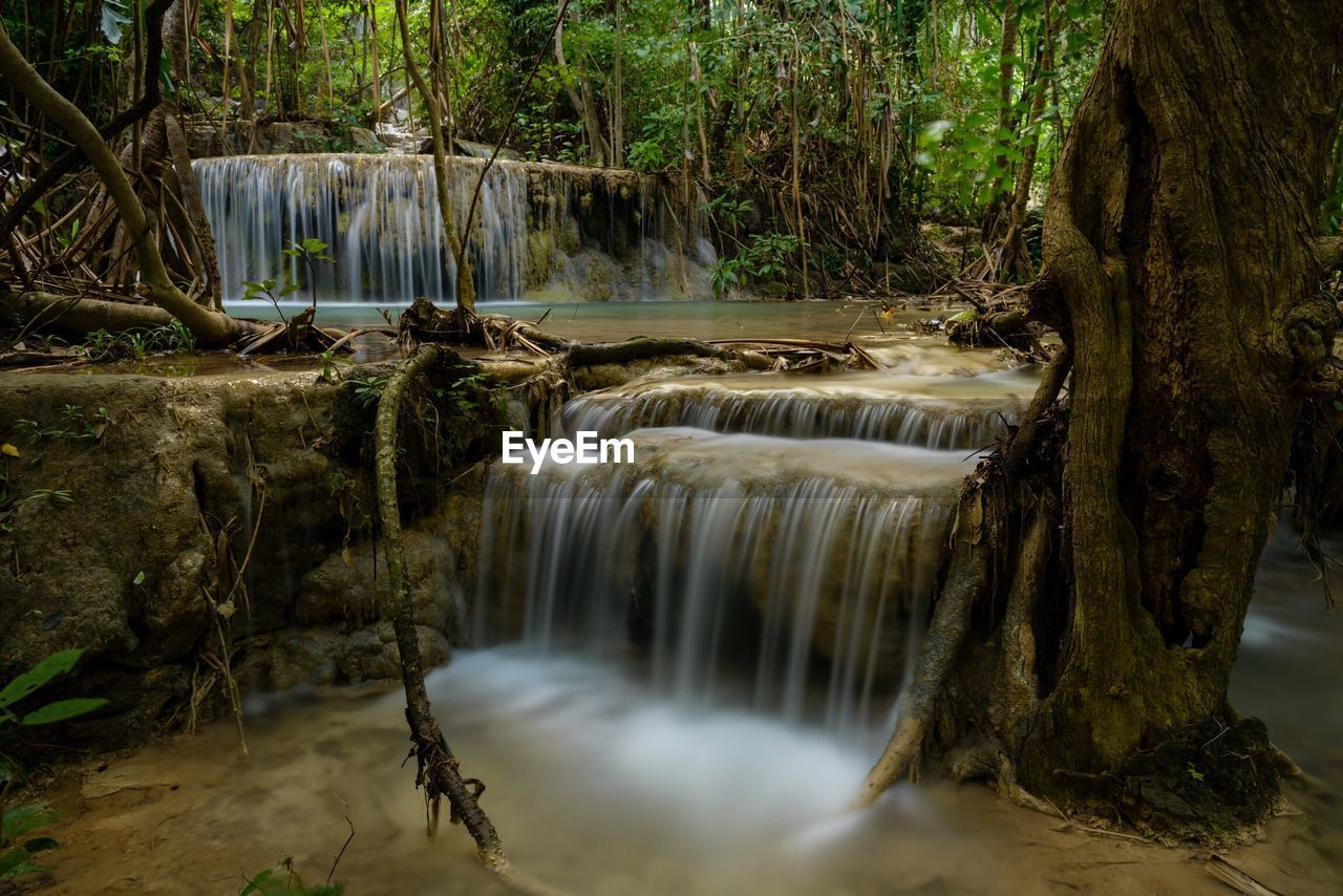 motion, waterfall, flowing water, long exposure, water, flowing, blurred motion, nature, beauty in nature, running water, tree, forest, river, outdoors, scenics, day, no people, hot spring