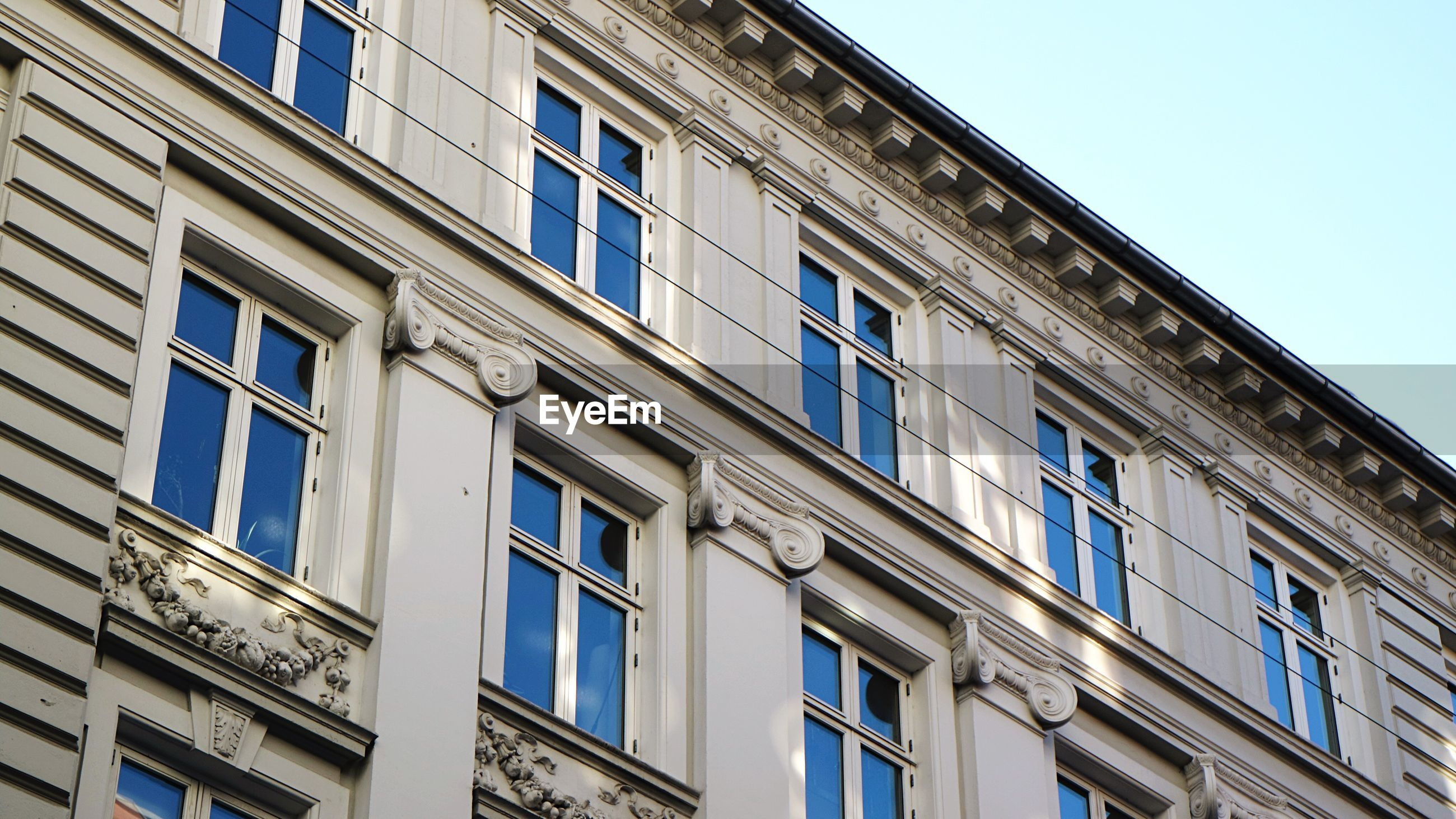LOW ANGLE VIEW OF BUILDING WITH WINDOWS
