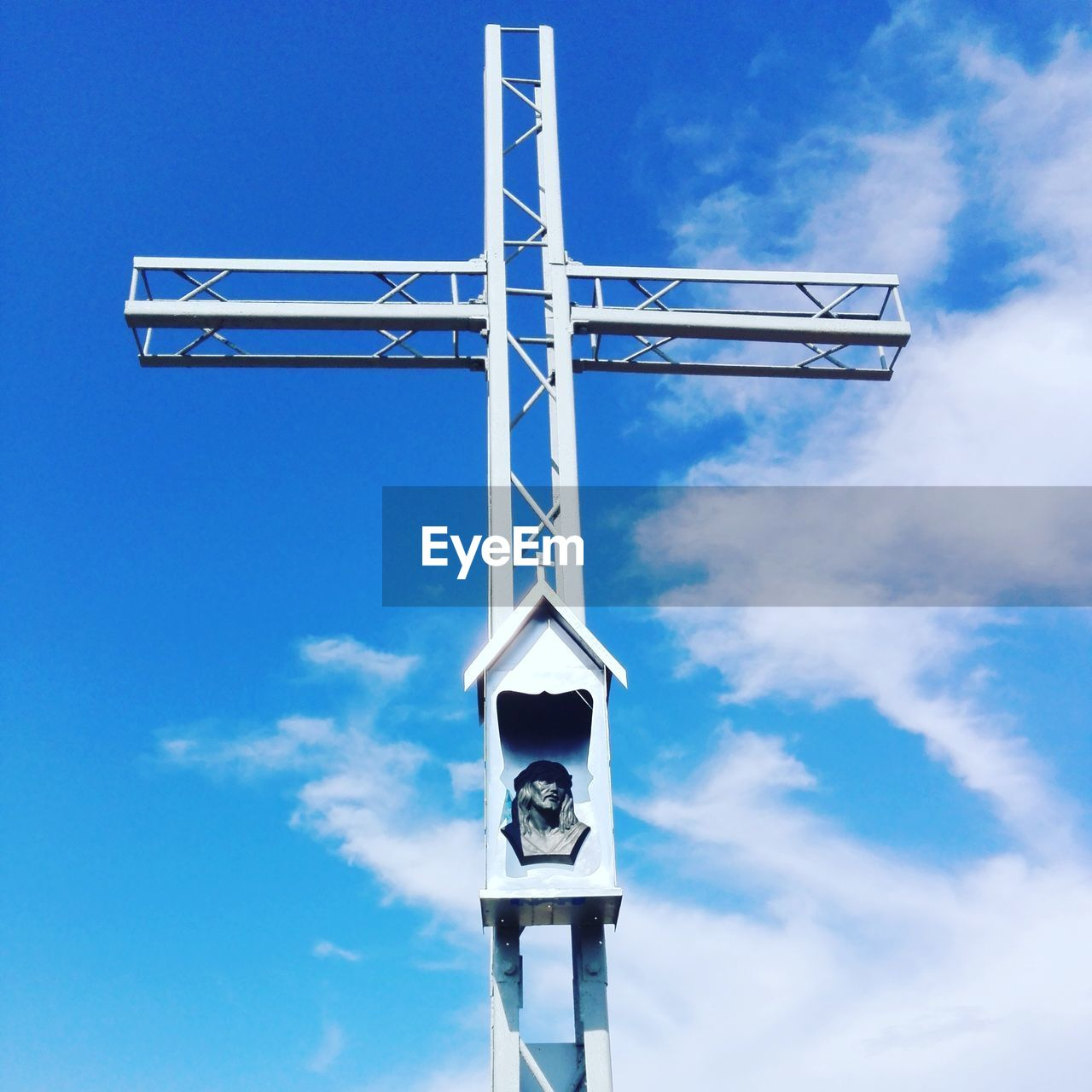 sky, cloud - sky, low angle view, blue, nature, day, no people, outdoors, metal, sunlight, belief, religion, spirituality, architecture, cross, built structure, technology, fuel and power generation, tower