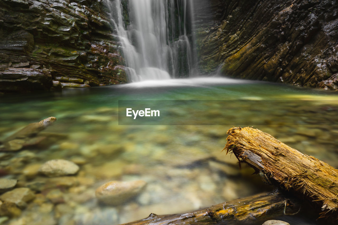 water, scenics - nature, waterfall, long exposure, flowing water, rock, beauty in nature, nature, motion, rock - object, solid, tree, blurred motion, forest, day, no people, wood - material, animal wildlife, outdoors, flowing, power in nature, falling water