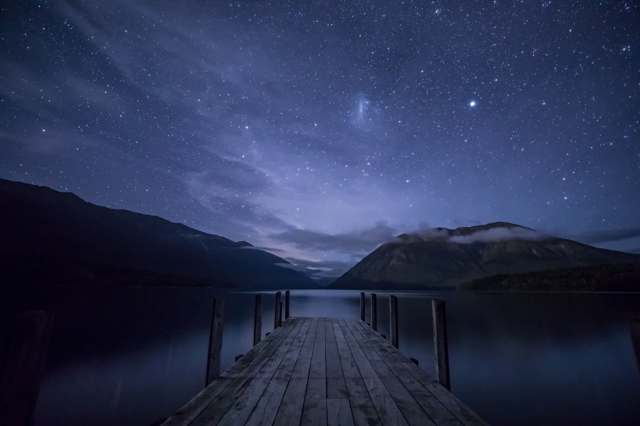 mountain, night, scenics, nature, beauty in nature, tranquil scene, outdoors, tranquility, star - space, lake, water, no people, sky, mountain range, galaxy, astronomy