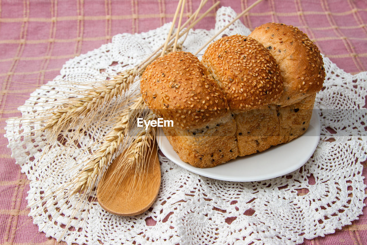 food and drink, food, baked, bread, freshness, indoors, healthy eating, close-up, no people, table, high angle view, wellbeing, still life, tablecloth, wholegrain, wheat, seed, bun, napkin, whole wheat, breakfast, brown bread