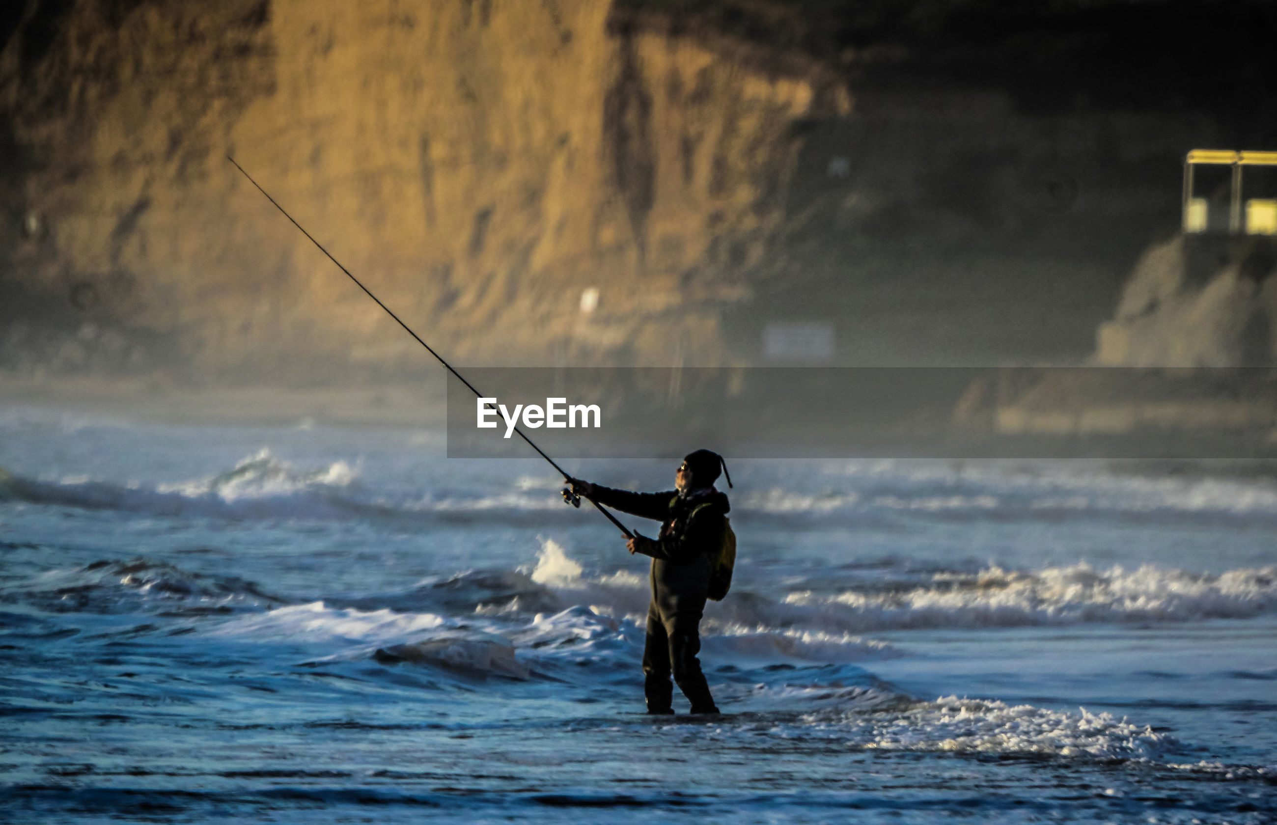 Side view of mature man fishing in sea